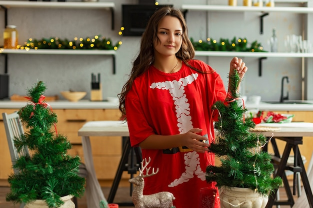 Girl in a room with christmas decorations