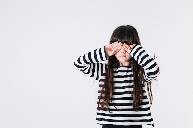 Girl rubbing eyes