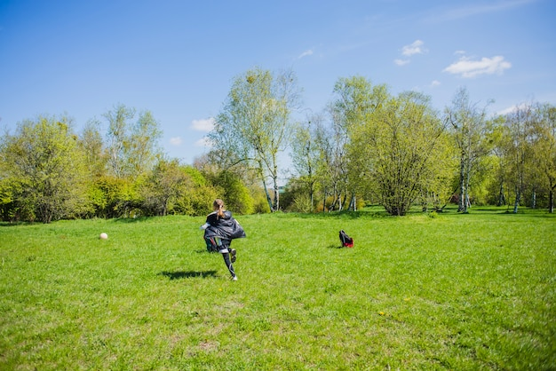 Girl running behind the ball