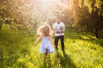 Girl running towards her father
