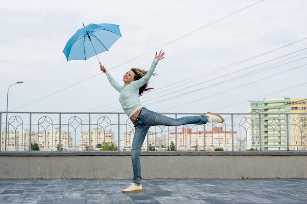 Girl runs behind an umbrella