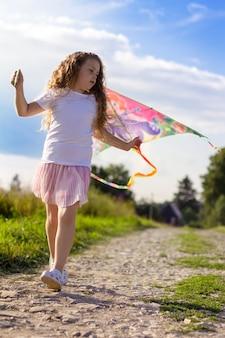 Girl runs with a kite