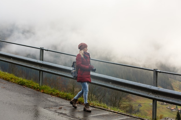Girl on a rural road in switzerland in the fog