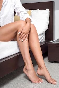 Girl's legs in the bedroom