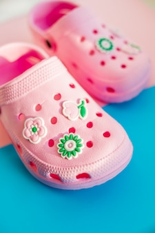 Girl's rubber sandals isolated on the bright background.