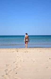 The girl on the sandy seashore