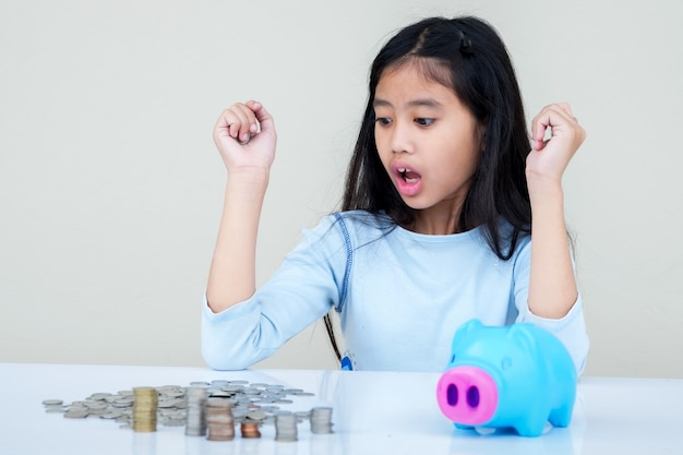 Girl saving money