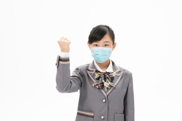 Girl in school uniform wearing mask with energy