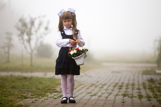 Girl in school uniform and white bows with flowers