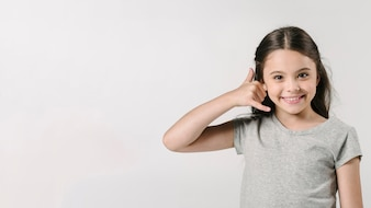 Girl showing call sign in studio