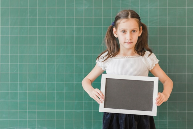 Girl showingchalkboard plate