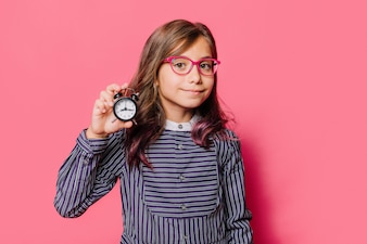 Girl showing clock