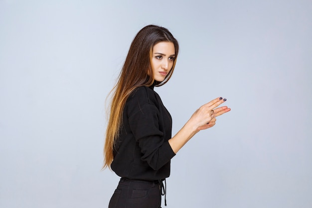 Girl showing gun sign in the hand. high quality photo