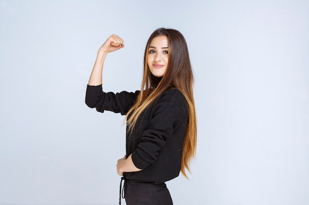 Girl showing her fist and strength. high quality photo