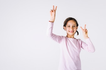 Girl showing peace gesture