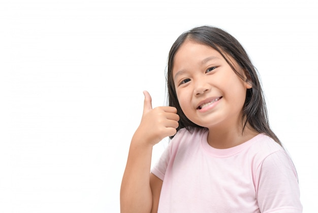 Girl showing thumbs up gesture isolated