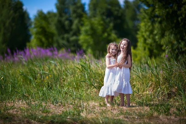 Girl sisters in the field
