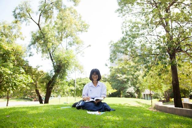 Girl sitting homework and reading.