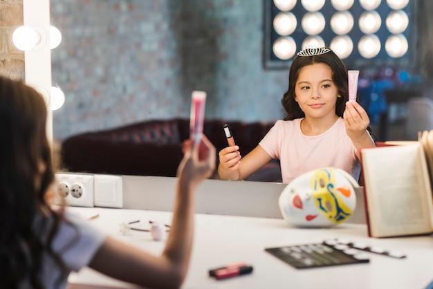Girl sitting in makeup room choosing cosmetic