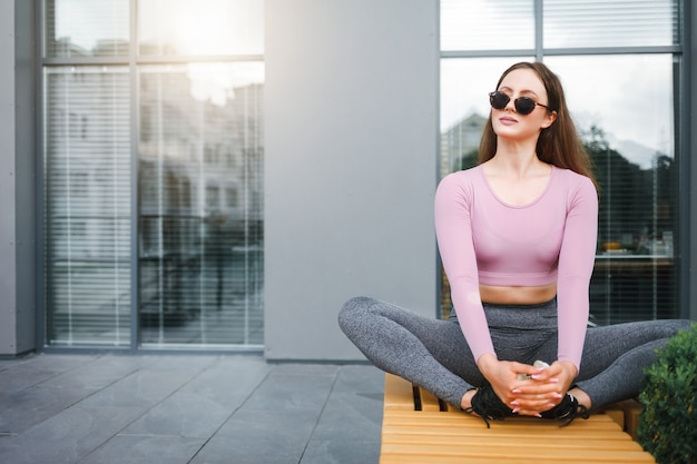 Girl sitting resting outdoors after exercise