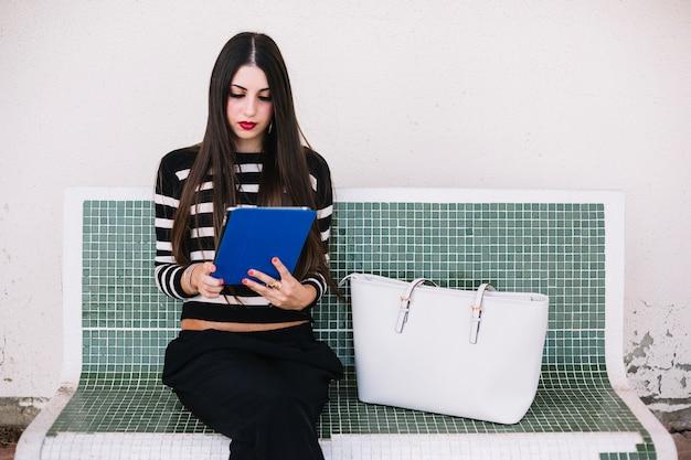Girl sitting with tablet