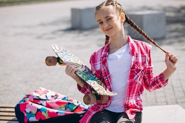 Girl skater in park