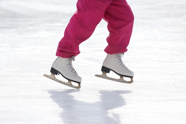 Girl skates on ice rink