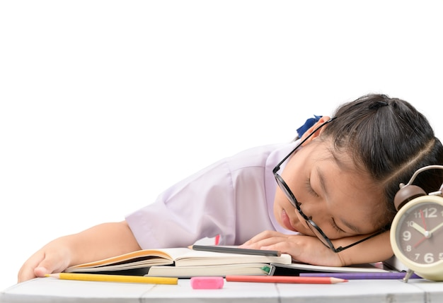 Girl sleep while doing hard homework isolated