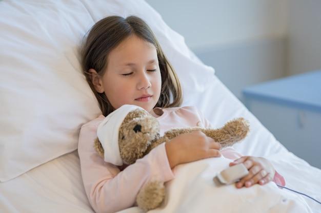 Girl sleeping in hospital bed