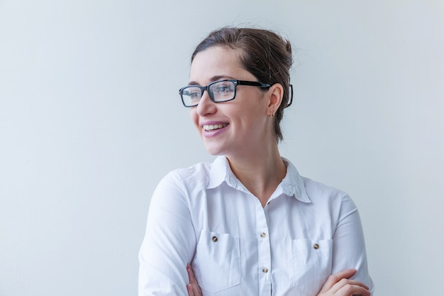 Girl smiling. portrait of young woman in eyeglasses isolated on white background. positive human emotion facial expression body language.