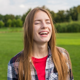 Girl smiling with her eyes closed