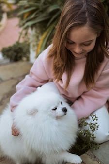Girl spending time with her puppy