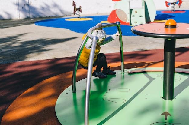 Girl spinning on carousel