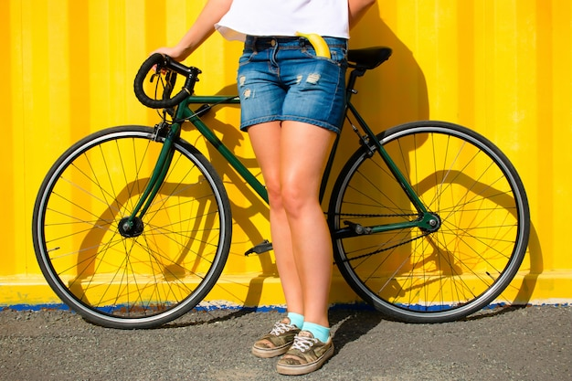 Girl and a sports bike on a yellow background