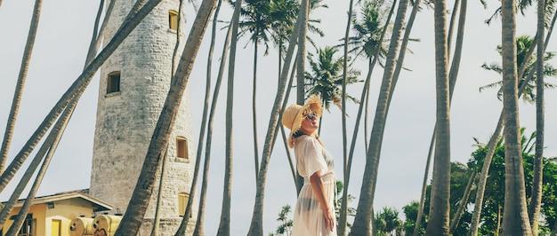 Girl in sri lanka on an island with a lighthouse
