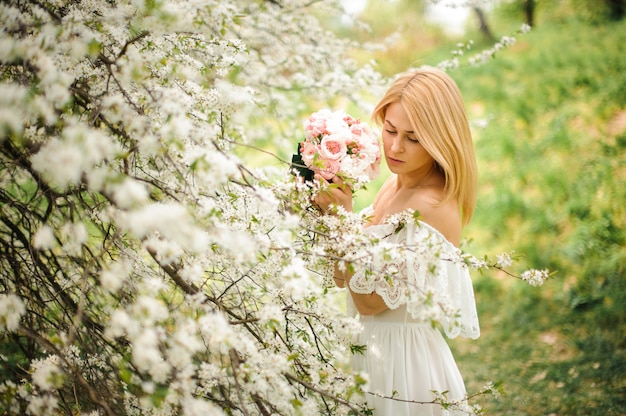 Girl standing between branches of bright white tree