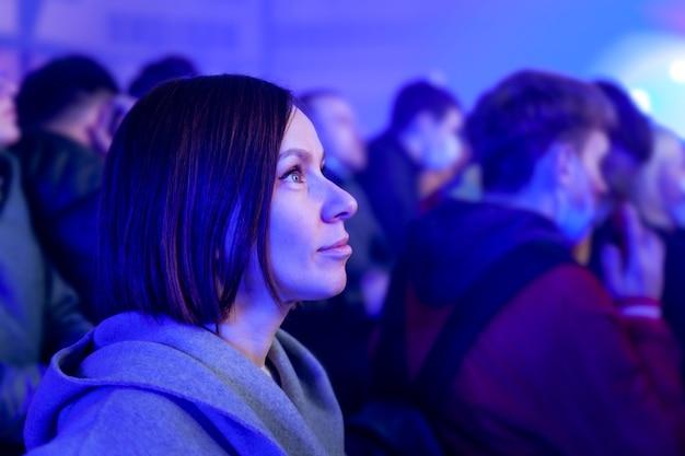 Girl standing at concert in neon light Premium Photo