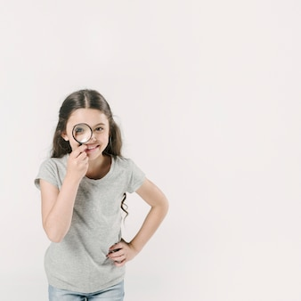Girl standing in studio with loupe