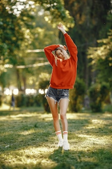 Girl standing in a summer park