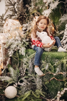 Girl standing on the upper level of christmas decoration