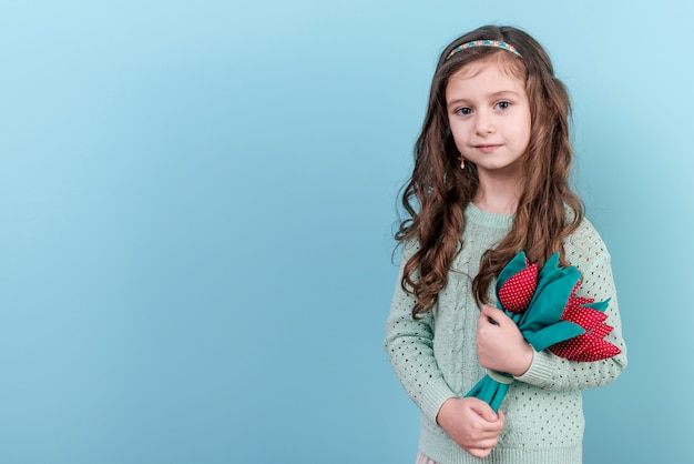 Girl standing with toy flowers