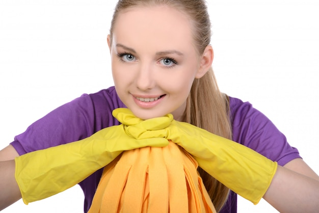 The girl stands in gloves for cleaning and looks.