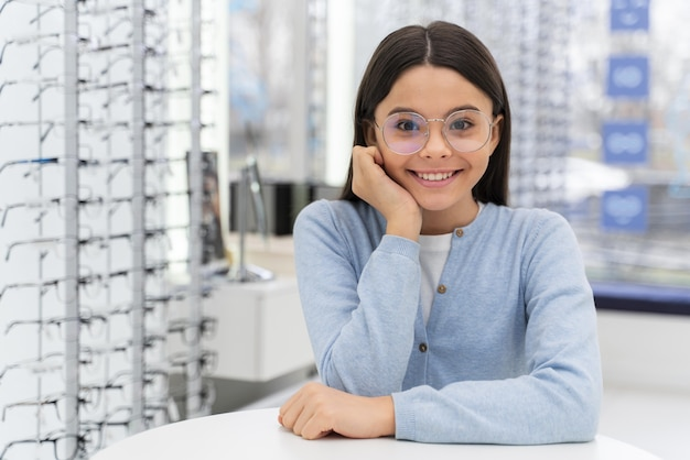 Girl in store trying on glasses
