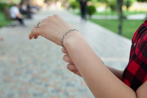 The girl straightens the bracelet