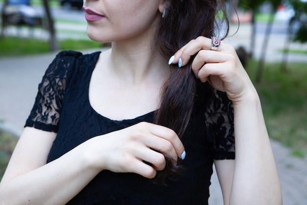 Girl straightens her hair in the park