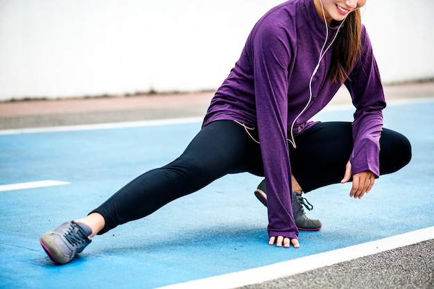 Girl stretching and getting ready for a workout