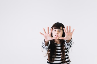 Girl stretching hands towards camera
