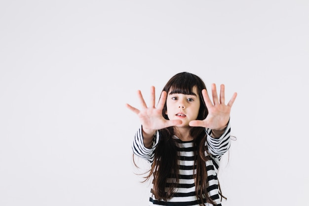 Girl stretching hands towards camera