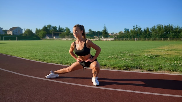 Girl stretching legs rolling from side to side