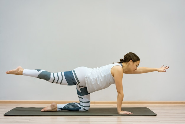 Girl in stretching position . sporty girl body curve health care perfect slim fit body lifestyle concept